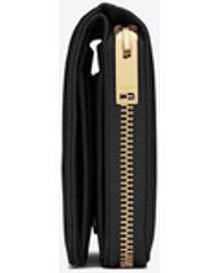 Saint Laurent MONOGRAMME portefeuille compact zippé en cuir embossé grain de poudre - Noir