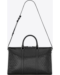 Saint Laurent MONOGRAM ALL OVER medium duffle bag in patent leather - Nero