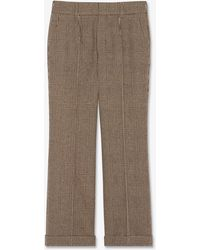 Saint Laurent Pleated Low-rise Trousers In Prince Of Wales Tweed - Natural