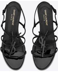 Saint Laurent Cassandra nu pieds en cuir verni et logo noir