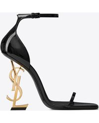 Saint Laurent OPYUM Sandale aus Lackleder mit goldfarbenem Absatz - Schwarz