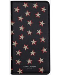 Saint Laurent Iphone X Case With A Flap In Shiny Star-print Leather - Black