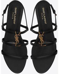 Saint Laurent Cassandra Flat Sandals In Smooth Leather With Gold-tone Monogram - Black
