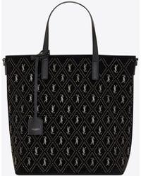 Saint Laurent Le monogramme shopping bag toy n/s in suede con borchie - Nero