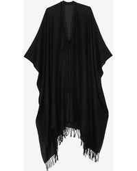 Saint Laurent Poncho à franges en toile de laine - Noir