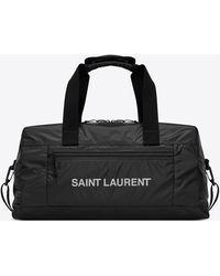 Saint Laurent Nuxx duffle bag in nylon with a print - Nero