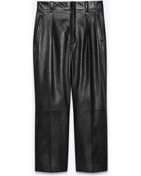 Saint Laurent Wide-leg Pleated Trousers In Lambskin - Black