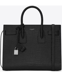 Saint Laurent Classic sac de jour small en cuir brillant embossé crocodile - Noir