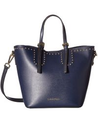 Calvin Klein - Novelty Studded Small Tote (navy) Tote Handbags - Lyst