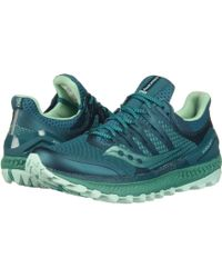 Saucony Xodus ISO3 (GreyCitron) De las mujeres Running Shoes. Dial
