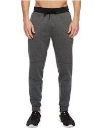 Reebok - Training Supply Knit Jogger (dark Grey Heather) Men's Casual Pants - Lyst