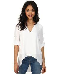 Karen Kane - Asymmetrical Hem Wrap Top (off White) Women's Blouse - Lyst