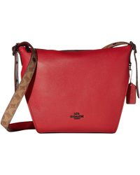 COACH Coated Canvas Signature Blocking Small Dufflette - Red