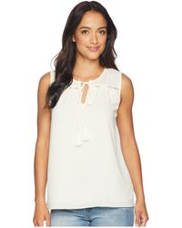 Cece - Sleeveless Tie Front Blouse With Tassel (antique White) Women's Sleeveless - Lyst