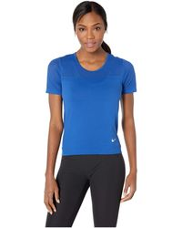 64761fb139e4e Nike - Infinite Top Short Sleeve (plum Dust reflective Silver) Women s  Clothing -