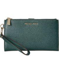 4291d9d2d49596 MICHAEL Michael Kors - Double Zip Wristlet (optic White) Wristlet Handbags  - Lyst