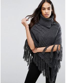 Cable Knit Poncho With Tassel Detail