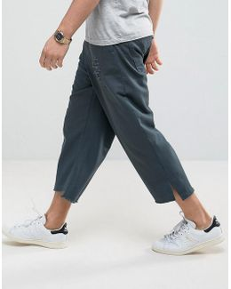 Oversized Pants With Rip And Repair Details And Stepped Hem