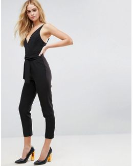 Wrap Front Jumpsuit With Peg Leg And Self Belt
