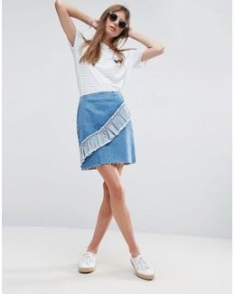 Denim Mini Skirt With Asymetric Ruffle In Mid Wash Blue