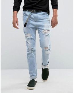 Tapered Jeans In Light Wash Blue With Heavy Rips