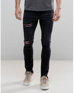Super Skinny Jeans In Washed Black With Heavy Rips And Hem Detail