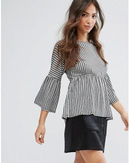 Gingham Top With Shirred Waist And Flared Sleeve