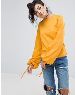 Top With Oversized Ruched Sleeve With Drawsting Detail