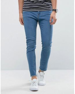 Skinny Light Blue Jeans With Raw Edge