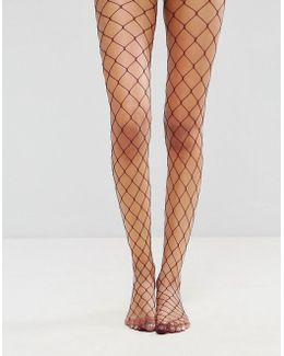 Oversized Fishnet Tights In Berry