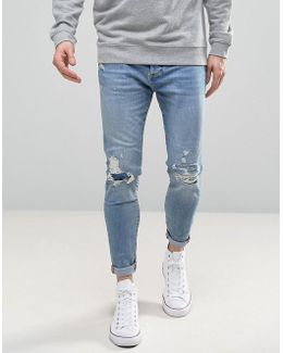 Carrot Fit Jeans With Rips In Light Wash