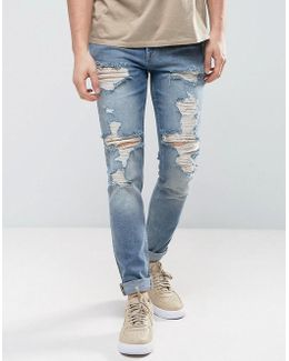 Skinny Jeans In Vintage Mid Wash Blue With Heavy Rips