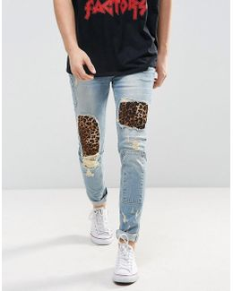 Skinny Jeans In Light Wash Blue With Punk Patches And Rips