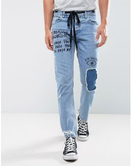 Slim Jeans In Vintage Mid Wash Blue With Rips And Print