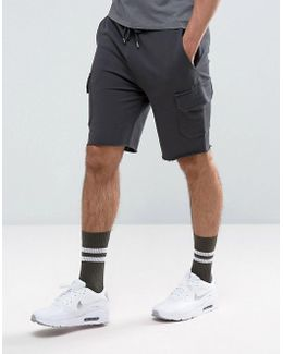 Skinny Jersey Shorts With Cargo Pockets In Washed Black