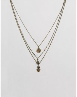 Layered Necklace With Mixed Charms In Burnished Gold