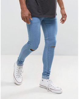 Super Skinny Jeans With Knee Rips And Raw Hem