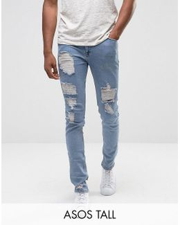 Tall Skinny Jeans In Light Wash Blue Vintage With Heavy Rips And Repair