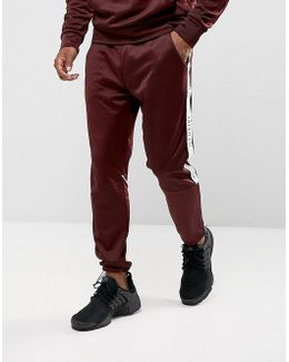 Skinny Track Joggers In Burgundy With Taping