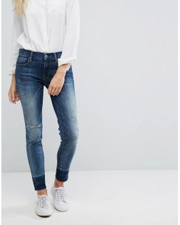 Mid Rise Skinny Stretch Jeans With Released Hem
