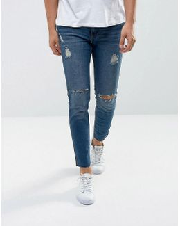 Man Ripped Skinny Jeans With Raw Hem In Mid Wash