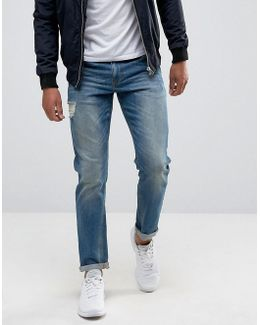 Stretch Slim Jeans In Mid Blue With Abrasions