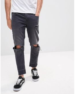 Slim Cropped Jeans With Knee Rips And Released Hems