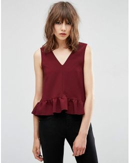 Dip Hem Ruffle Vest With Raw Edge