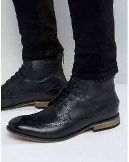 Brogue Boots In Black Leather With Natural Sole
