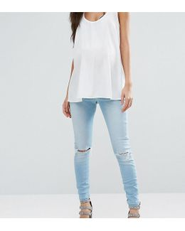 Ridley Skinny Jeans In Felix Midwash With Busted Knees And Chewed Hems With Under The Bump Waistband