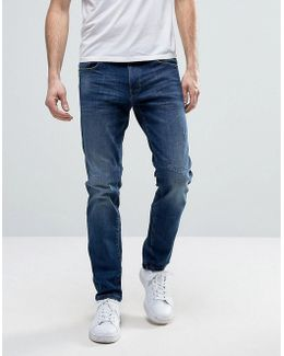 Relaxed Slim Fit Jeans With Distressing