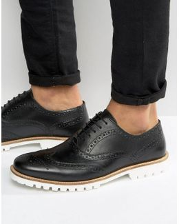 Brogue Shoes In Black Leather With White Cleated Sole