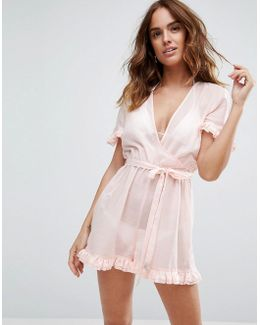 Beach Romper With Short Sleeves And Frill Detail