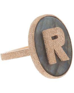 'r' Initial Ring